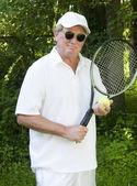 Middle age senior tennis player male demonstating stroke — Stock Photo