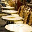 Night scene Paris France cafe setting tables chairs — Stock Photo #13080706