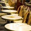 Night scene Paris France cafe setting tables chairs — Stock Photo