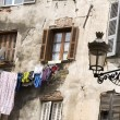 Stock Photo: Laundry hanging medieval architecture basticorsica