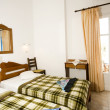 Interior guest house triple room Greek Island Ios — Stock Photo #13085714