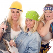 Stock Photo: Team of three sexy women workers contractors with tools