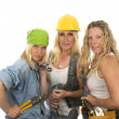 Team of three sexy women workers contractors with tools — Stock Photo