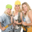 Team of three sexy women workers contractors with tools — Stock Photo #13088646