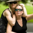 Two sexy middle age women on motorcycle - Foto Stock