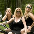 Stock Photo: Three sexy middle age women on motorcycle