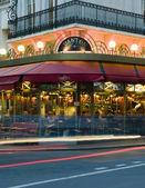 Paris bistro cafe with dining night car light — Stock Photo