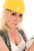 Sexy contractor construction lady writing a contract estimate — Stock Photo