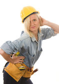 Attractive woman contractor with tools and hard hat helmet — Stock Photo