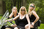 Sexy group blond women on large motorcycle — Stock Photo