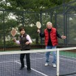Stock Photo: Mand womplaying paddle platform tennis