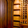 Mahogany door and wine cellar — Stock Photo #13094085