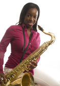 Young african american girl playing saxophone music — Stock Photo