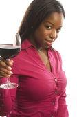 Attractive dark hispanic woman toasting with glass of wine — Stock Photo
