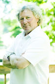 Middle age senior man portrait tennis shirt — Stock Photo