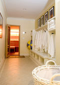 Locker room with bathrobes towels — Stock Photo