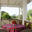 Dining table patio budget guest house bequia - Stock Photo