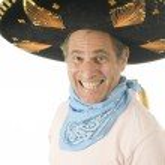 Middle age senior tourist male wearing Mexican sombrero hat cowboy bandana — Stock Photo