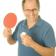 Senior man playing ping-pong table tennis — 图库照片