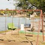 Swing set ride children's park Brig Bay Corn Island — Stock Photo #13398293