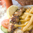 Photograph of pork souvlaki with tzatiki house wine bread — Stock Photo