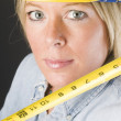 Pretty blond female construction worker hard hat helmet - Stock Photo