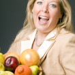 Woman with bowl of fruit — Stock Photo