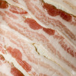 Stock Photo: Raw bacon strips on paper towel for microwave