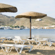 Beach with umbrellas lounge chairs Ios Island Cyclades Greece — Stock Photo #13399666