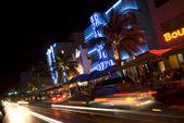 Art deco hotel neon lights night scene — Stock Photo