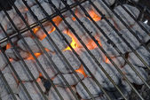 Charcoals flaming in the grill — Stock Photo