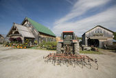 Tractor tiller in front of garden center in rural vermont — Stok fotoğraf