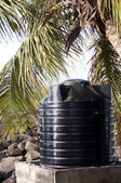 Plastic water tank storage system caribbean islands — Stock Photo