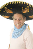 Middle age senior tourist male wearing Mexican sombrero hat cowboy bandana — Foto Stock