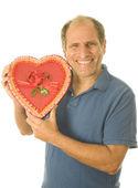 Middelbare leeftijd senior mens vak van valentine dag chocolade snoep — Stockfoto