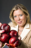 Attractive blond woman with plums fruit for healthy life — Stock Photo