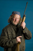 Handsome middle age man flag bandana leather jacket firearm weapon — Stock Photo