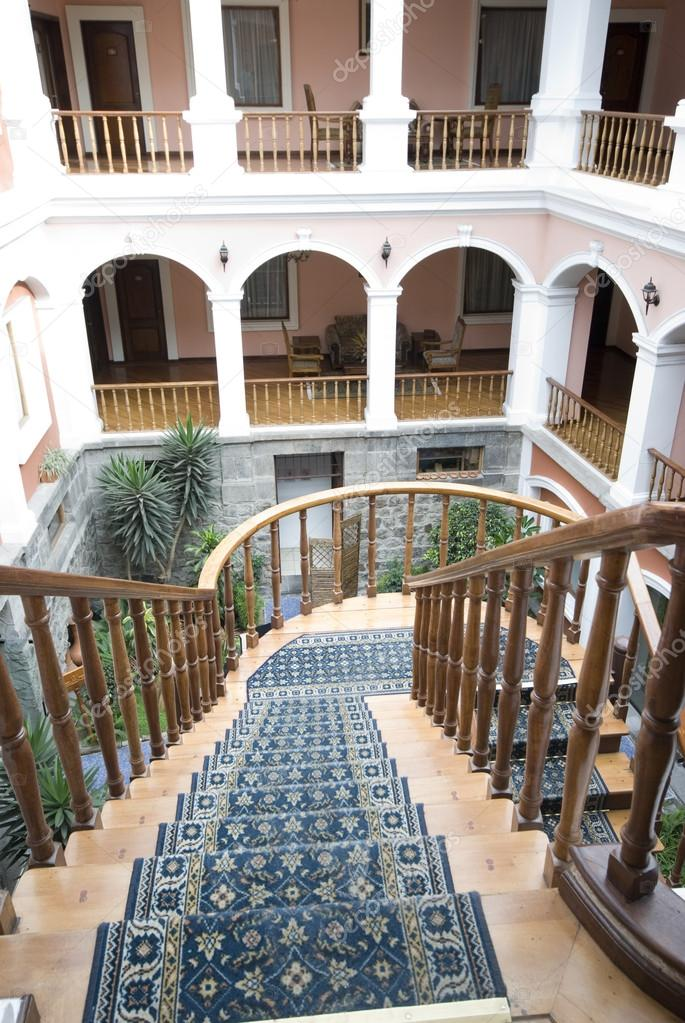 Classic historic architecture arches staircase atrium historic hotel quito ecuador — Stock Photo #13396121