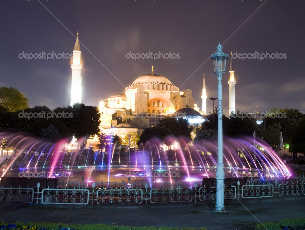 The Hagia Sophia mosque museum with fountain night scene with lights Istanbul Constantinople Turkey — Stock Photo #13398756
