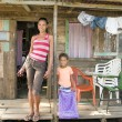 Nicaragua mother daughter clapboard  house Corn Island - Stock Photo