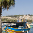 Marsaxlokk malta fishing village luzzu boat — Stock Photo #13415887