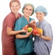 Постер, плакат: Group of nurses with healthy fruits and vegetables