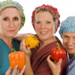 Stock Photo: Nurses promoting healthy diet with fresh colorful bell peppers