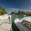 Canal with boats and homes florida keys - Stock Photo