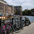 Stock Photo: Bicycles on canal amsterdam holland