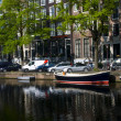 Canal scene amsterdam holland europe — Stock Photo #13414360