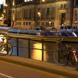 Stock Photo: Boats on canal with bicycles night amsterdam holland