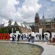 Editorial tourists at i amsterdam sign by rijksmuseum amsterdam — Foto Stock