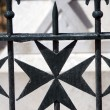 Maltese cross wrought iron fence - Stock Photo