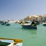 Luzzu boat marsaxlokk harbor malta — Stock Photo #13415751